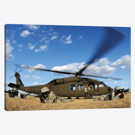 Airmen Provide Security In Front Of A UH-60 Black Hawk Canvas Print #TRK670} by Stocktrek Images Canvas Art