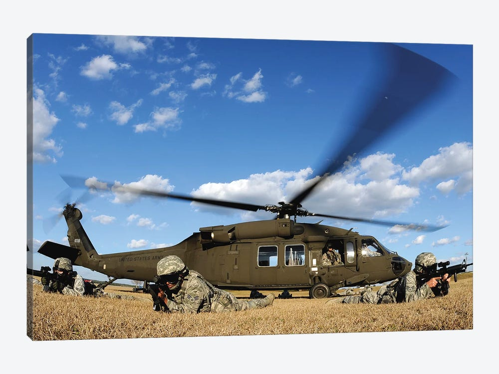Airmen Provide Security In Front Of A UH-60 Black Hawk by Stocktrek Images 1-piece Canvas Artwork