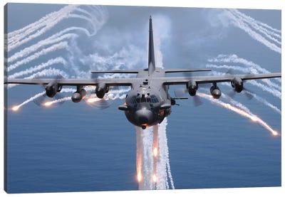 An AC-130H Gunship Aircraft Jettisons Flares As An Infrared Countermeasure Canvas Art Print