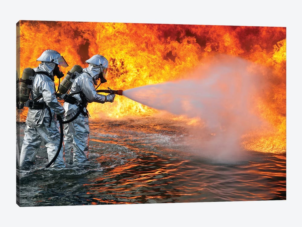 An Aircraft Rescue Firefighting Team Attempts To Spray Out A Fuel Fire by Stocktrek Images 1-piece Canvas Wall Art
