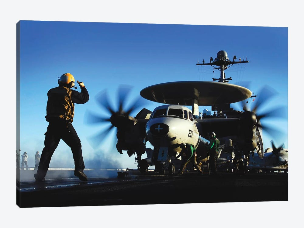 An Airman Guides An E-2C Hawkeye by Stocktrek Images 1-piece Canvas Art Print