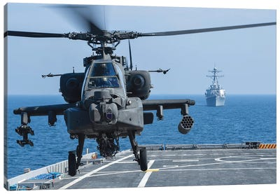 An Army Ah-64D Apache Helicopter Takes Off From USS Ponce Canvas Art Print