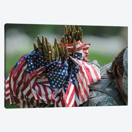 An Army Soldier's Backpack Overflows With Small American Flags Canvas Print #TRK685} by Stocktrek Images Canvas Wall Art