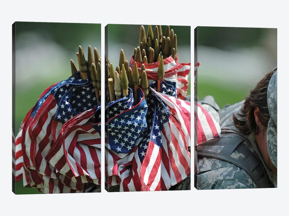 An Army Soldier's Backpack Overflows With Small American Flags by Stocktrek Images 3-piece Canvas Art