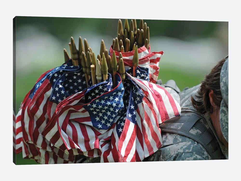 An Army Soldier's Backpack Overflows With Small American Flags by Stocktrek Images 1-piece Canvas Art