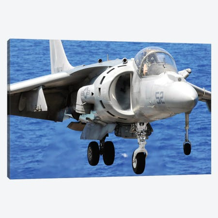 An AV-8B Harrier Jet Lands On The Flight Deck Of USS Peleliu Canvas Print #TRK688} by Stocktrek Images Canvas Art Print