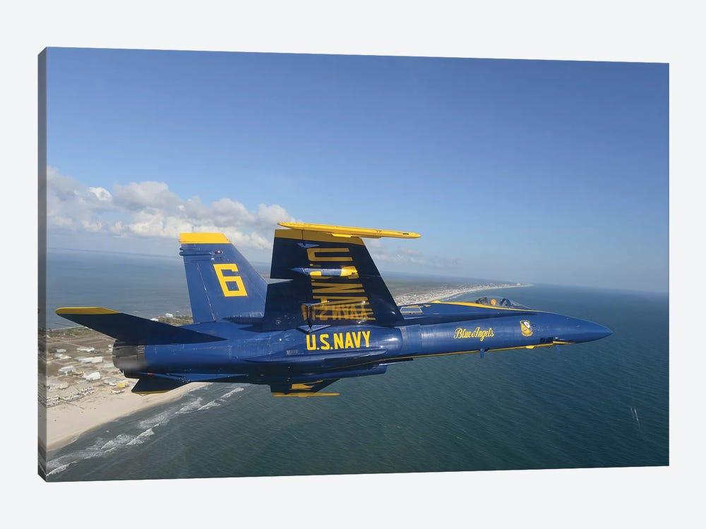 An F/A-18 Hornet From The Blue Angels Flies A Training Sortie by Stocktrek Images 1-piece Art Print