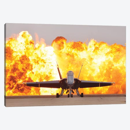 An F/A-18 Hornet Sits On The Flight Line As A Wall Of Fire Detonates Behind It Canvas Print #TRK698} by Stocktrek Images Canvas Wall Art