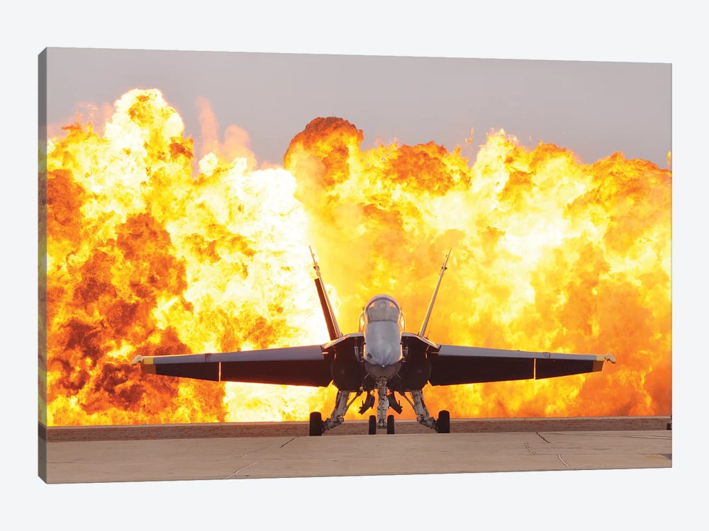 An F/A-18 Hornet Sits On The Flight Line As A Wall Of Fire Detonates Behind It by Stocktrek Images 1-piece Canvas Art