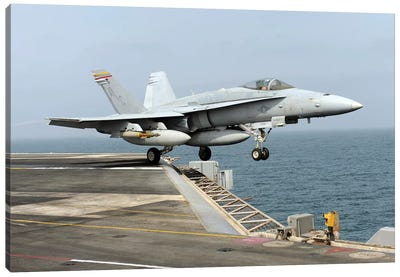 An F/A-18C Hornet Launches From The Aircraft Carrier USS Harry S. Truman Canvas Art Print