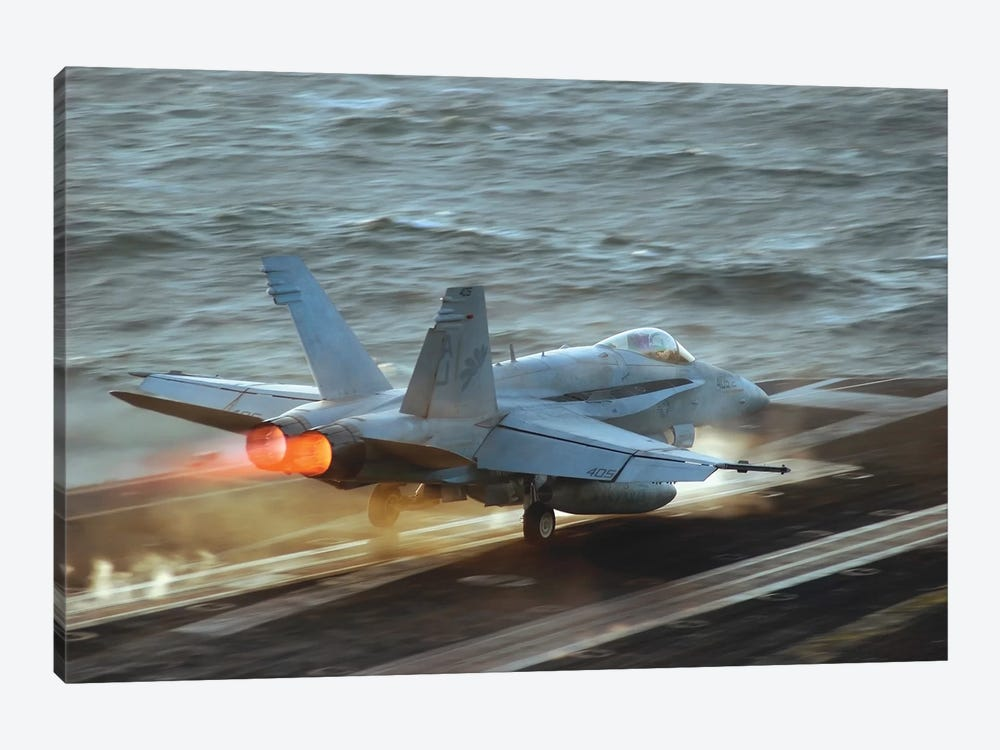 An F/A-18C Hornet Launches From The Flight Deck Of USS Theodore Roosevelt by Stocktrek Images 1-piece Art Print