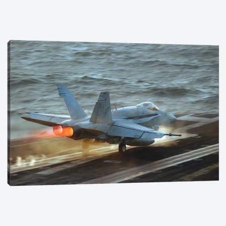 An F/A-18C Hornet Launches From The Flight Deck Of USS Theodore Roosevelt Canvas Print #TRK705} by Stocktrek Images Canvas Art Print