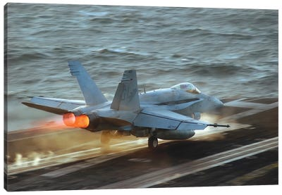 An F/A-18C Hornet Launches From The Flight Deck Of USS Theodore Roosevelt Canvas Art Print