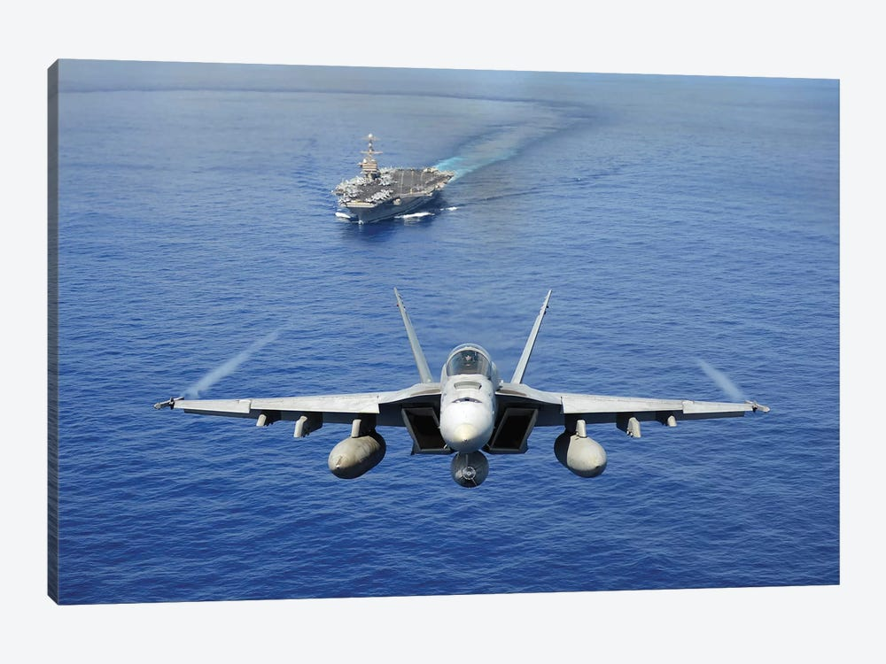 An F/A-18E Super Hornet Flying Above USS John C. Stennis by Stocktrek Images 1-piece Canvas Art