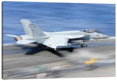 An F/A-18E Super Hornet Launches From The Aircraft Carrier USS George Washington Canvas Art Print