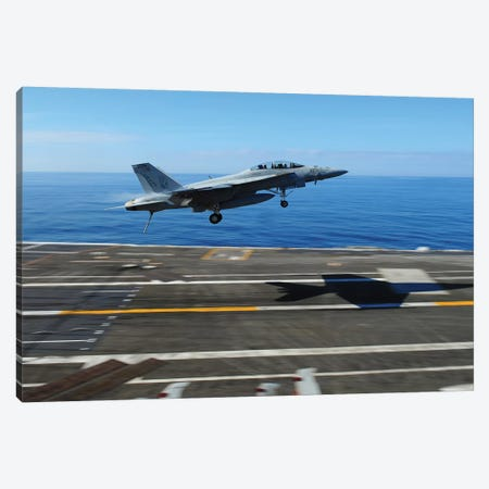 An F/A-18F Super Hornet Flies Over The Flight Deck Of USS George HW Bush Canvas Print #TRK714} by Stocktrek Images Canvas Wall Art