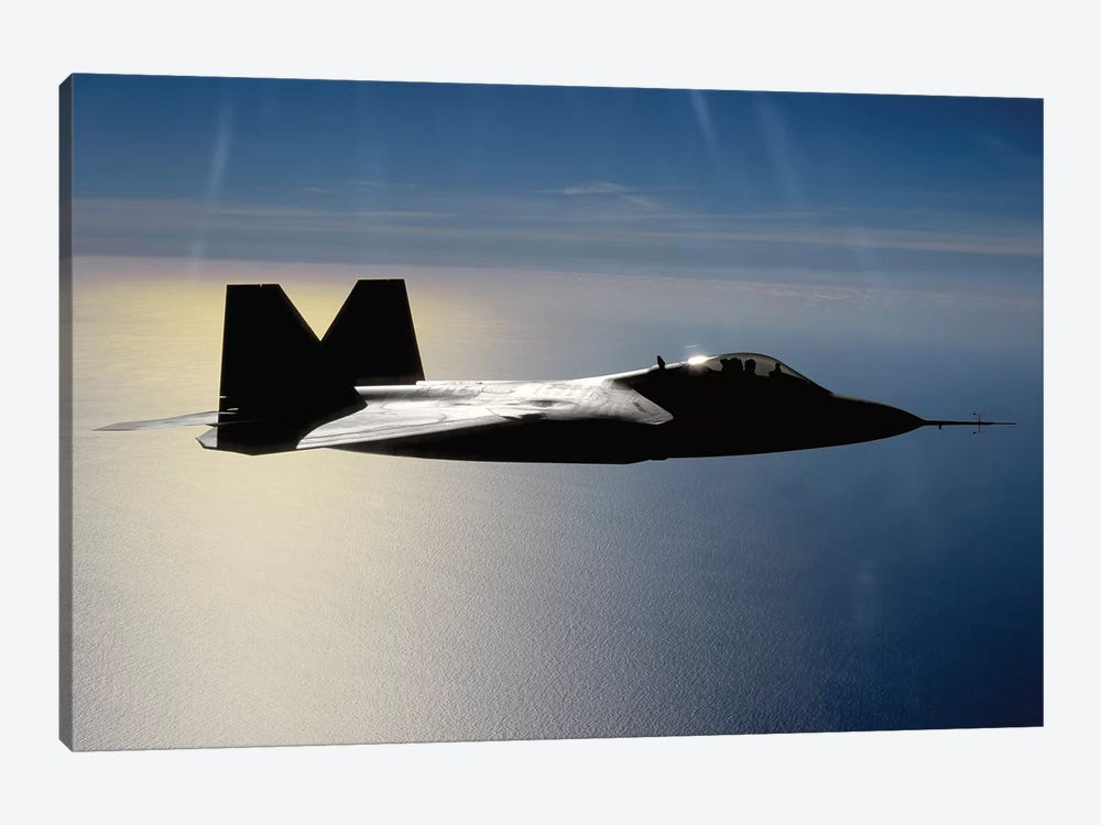 An F/A-22 Raptor Flies A Training Mission II by Stocktrek Images 1-piece Canvas Artwork