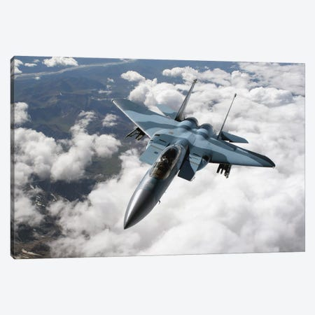 An F-15C Aggressor Flies Over A Mountain Range Canvas Print #TRK725} by Stocktrek Images Canvas Art Print