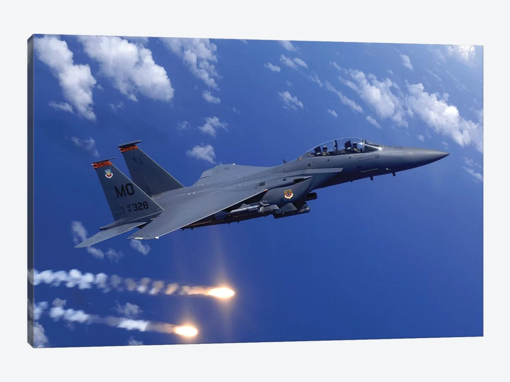 An F-15E Strike Eagle Fires Flares During An Aerial Training Dog Fight Off The Coast Of Guam by Stocktrek Images 1-piece Canvas Art Print