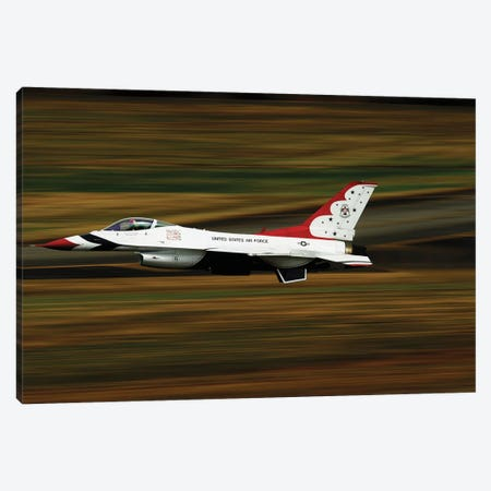 An F-16 Thunderbird Of The US Air Force Flying At High Speed Canvas Print #TRK737} by Stocktrek Images Canvas Artwork