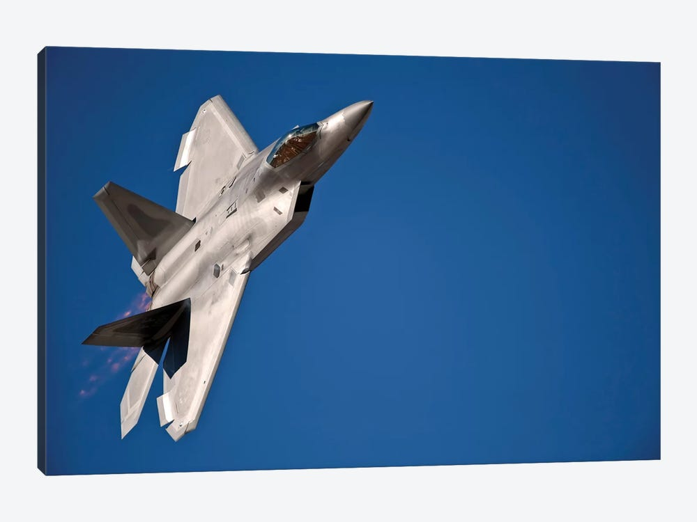 An F-22 Raptor Aircraft Performs During Aviation Nation 2010 by Stocktrek Images 1-piece Canvas Print