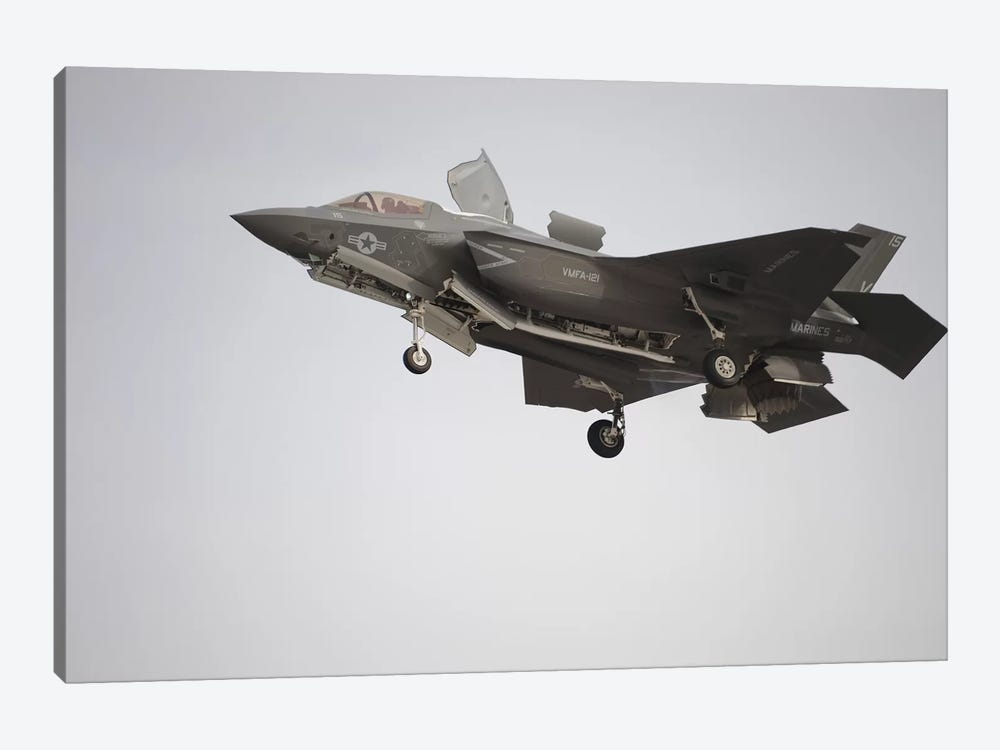 An F-35B Lightning II Joint Strike Fighter Prepares To Make A Vertical Landing by Stocktrek Images 1-piece Canvas Print