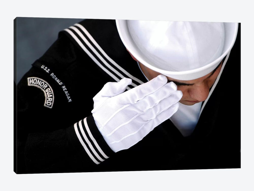 An Honor Guard Member Renders A Salute During A Burial At Sea Ceremony by Stocktrek Images 1-piece Art Print