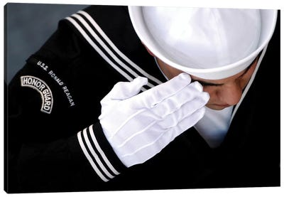 An Honor Guard Member Renders A Salute During A Burial At Sea Ceremony Canvas Art Print