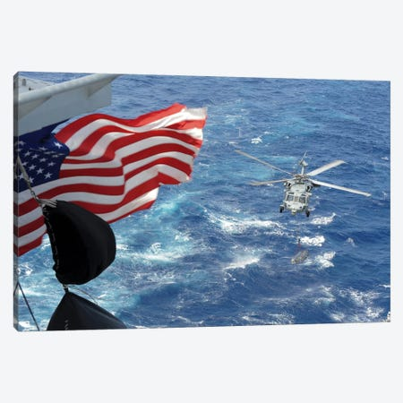 An MH-60S Sea Hawk Carries Supplies During A Replenishment At Sea Canvas Print #TRK751} by Stocktrek Images Canvas Print
