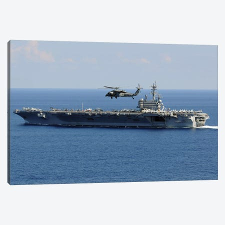 An MH-60S Seahawk Helicopter Flies Over USS George H.W. Bush Canvas Print #TRK753} by Stocktrek Images Art Print