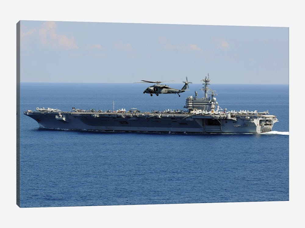An MH-60S Seahawk Helicopter Flies Over USS George H.W. Bush by Stocktrek Images 1-piece Canvas Art