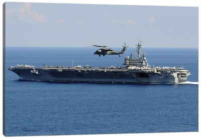 An MH-60S Seahawk Helicopter Flies Over USS George H.W. Bush Canvas Art Print