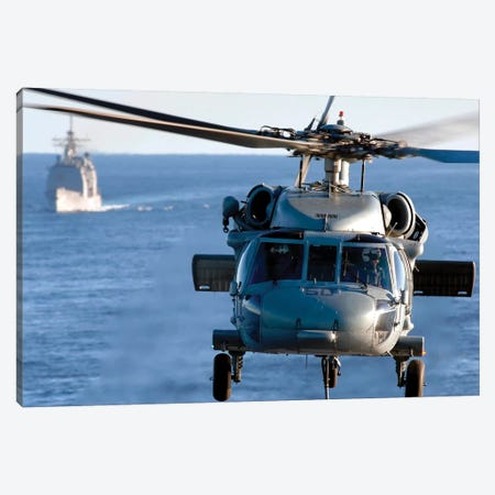 An MH-60S Seahawk Helps Conduct A Vertical Replenishment Canvas Print #TRK754} by Stocktrek Images Canvas Artwork