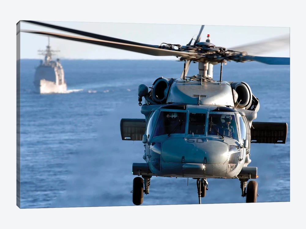 An MH-60S Seahawk Helps Conduct A Vertical Replenishment by Stocktrek Images 1-piece Canvas Print
