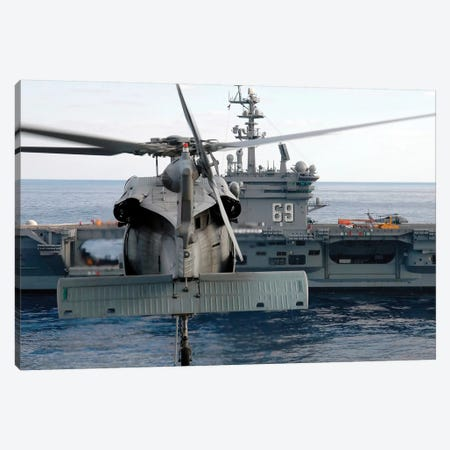 An MH-60S Seahawk Hovers Prior To Taking A Load Of Ammunition To USS Dwight D. Eisenhower Canvas Print #TRK755} by Stocktrek Images Canvas Art