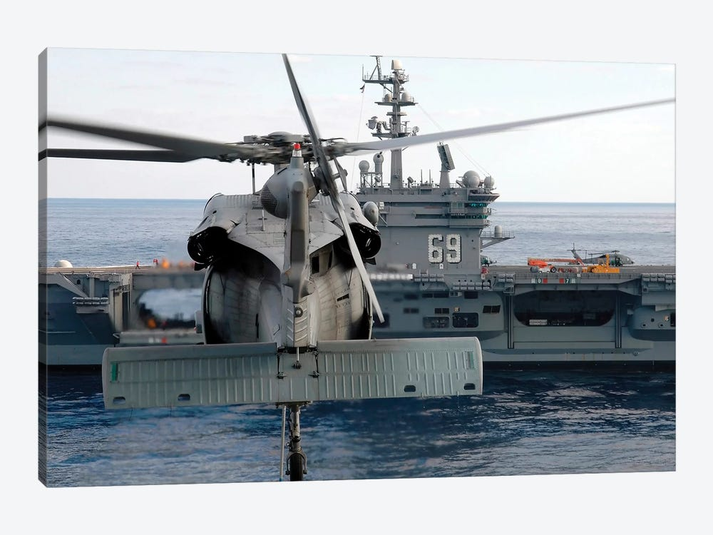 An MH-60S Seahawk Hovers Prior To Taking A Load Of Ammunition To USS Dwight D. Eisenhower by Stocktrek Images 1-piece Canvas Wall Art