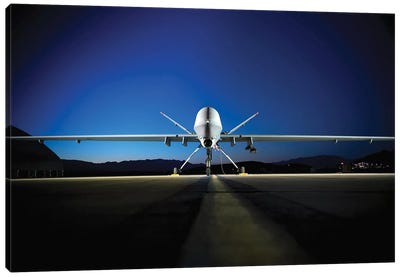 An MQ-9 Reaper Sits On The Flight line Canvas Art Print