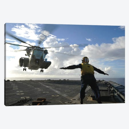 Aviation Boatswain's Mate Directs A CH-53E Super Stallion Onto The Flight Deck Of USS Harpers Ferry Canvas Print #TRK763} by Stocktrek Images Canvas Artwork