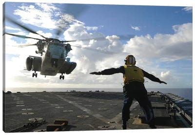 Aviation Boatswain's Mate Directs A CH-53E Super Stallion Onto The Flight Deck Of USS Harpers Ferry Canvas Art Print