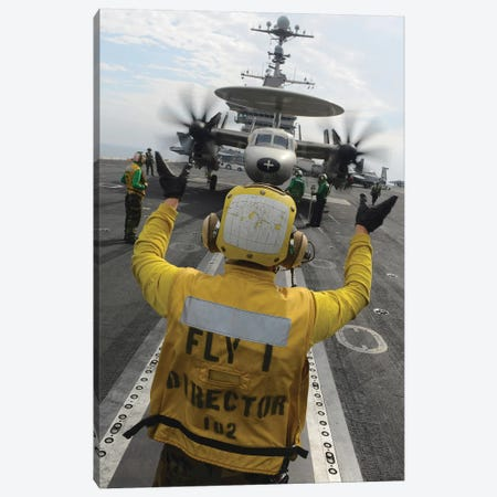 Aviation Boatswain's Mate Directs An E-2C Hawkeye Aboard USS John C. Stennis Canvas Print #TRK765} by Stocktrek Images Canvas Print