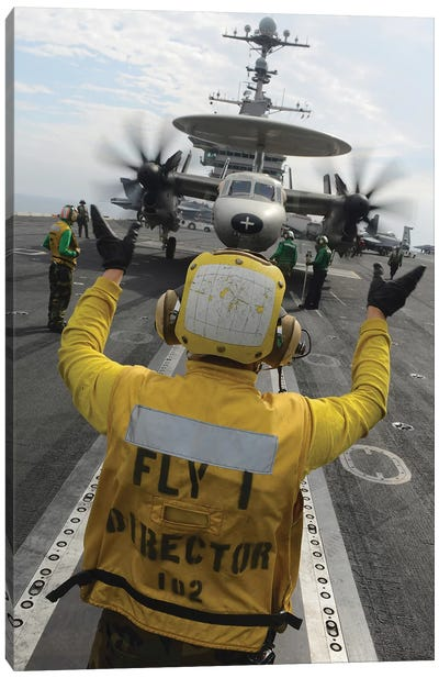 Aviation Boatswain's Mate Directs An E-2C Hawkeye Aboard USS John C. Stennis Canvas Art Print