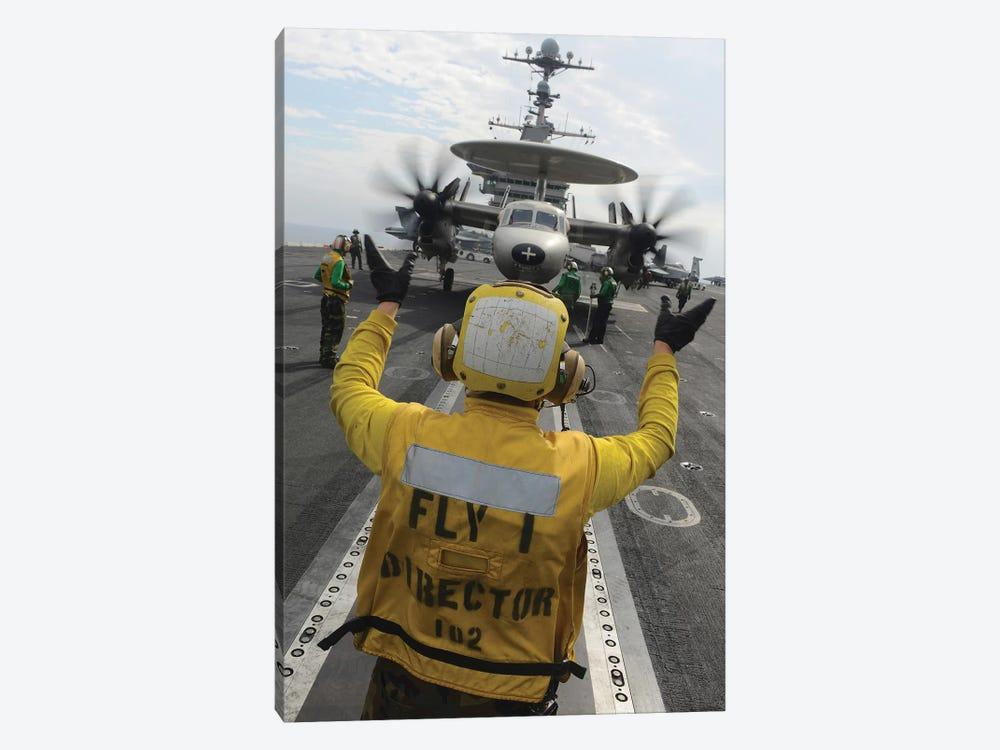 Aviation Boatswain's Mate Directs An E-2C Hawkeye Aboard USS John C. Stennis by Stocktrek Images 1-piece Art Print