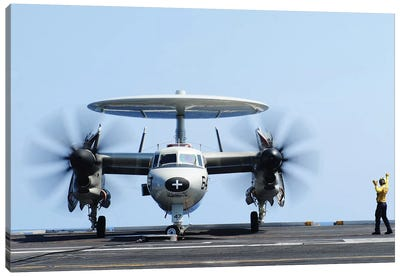 Aviation Boatswain's Mate Directs An E-2C Hawkeye On The Flight Deck Canvas Art Print