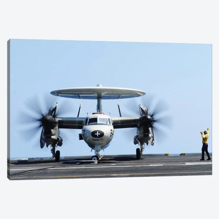 Aviation Boatswain's Mate Directs An E-2C Hawkeye On The Flight Deck Canvas Print #TRK766} by Stocktrek Images Canvas Art Print