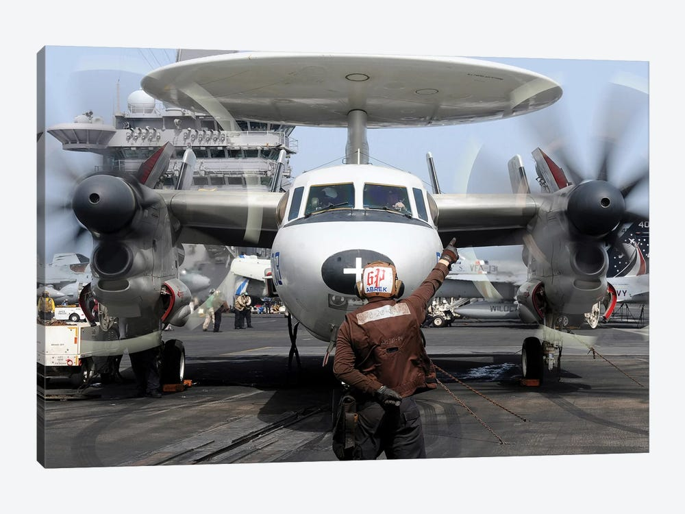 Aviation Electronics Technician Directs An E-2C Hawkeye To Start Its Engines by Stocktrek Images 1-piece Canvas Wall Art