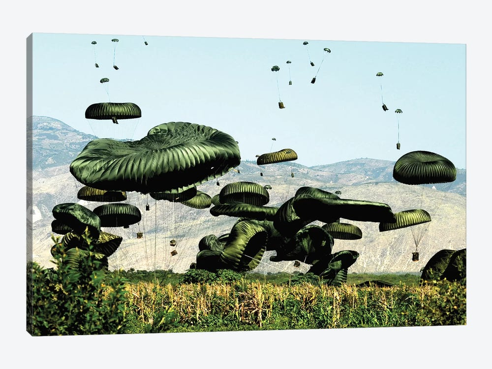 Bundles Of Food And Water Are Air Delivered To The Outlying Area Of Port-Au-Prince, Haiti by Stocktrek Images 1-piece Canvas Wall Art