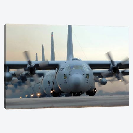 C-130 Hercules Aircraft Taxi Out For A Mission During A Six-Ship Sortie Canvas Print #TRK776} by Stocktrek Images Canvas Wall Art