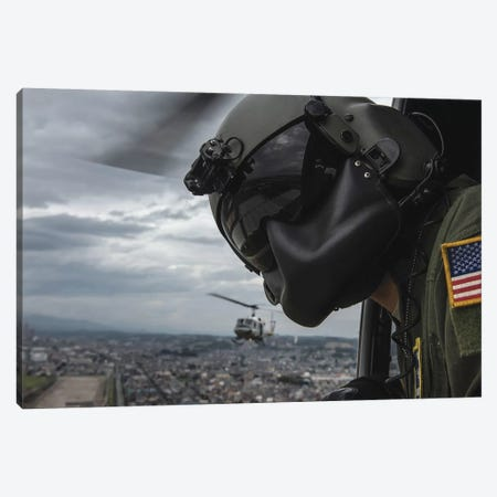 Crew Chief Scans The Area From A UH-1N Huey Helicopter Canvas Print #TRK787} by Stocktrek Images Art Print