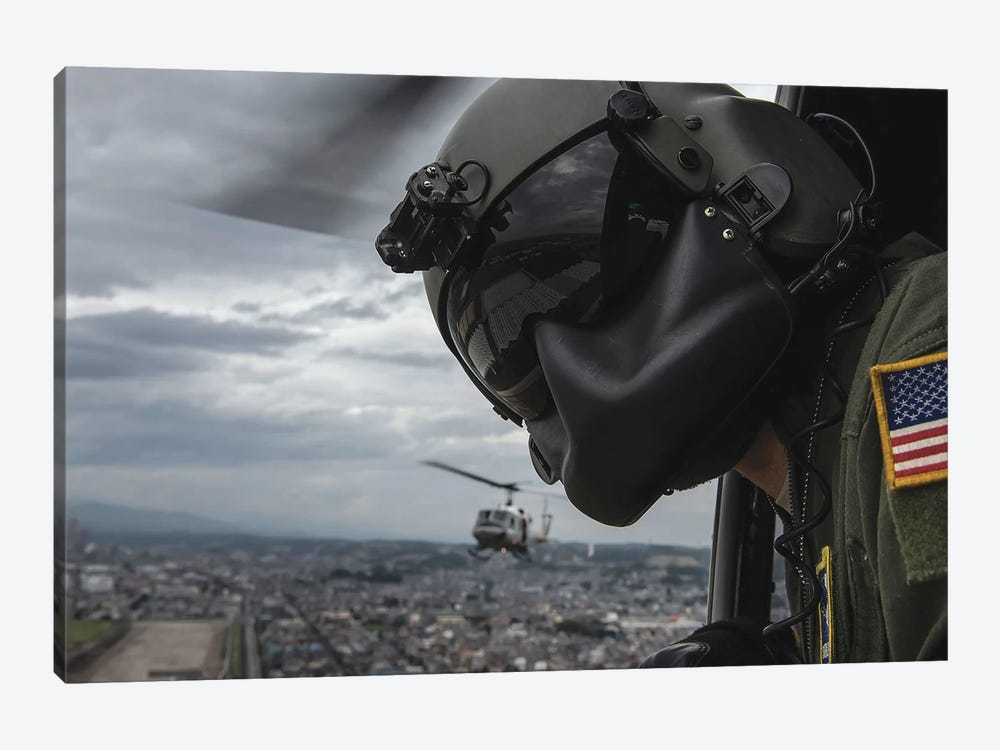 Crew Chief Scans The Area From A UH-1N Huey Helicopter by Stocktrek Images 1-piece Canvas Print