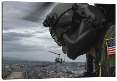 Crew Chief Scans The Area From A UH-1N Huey Helicopter Canvas Art Print